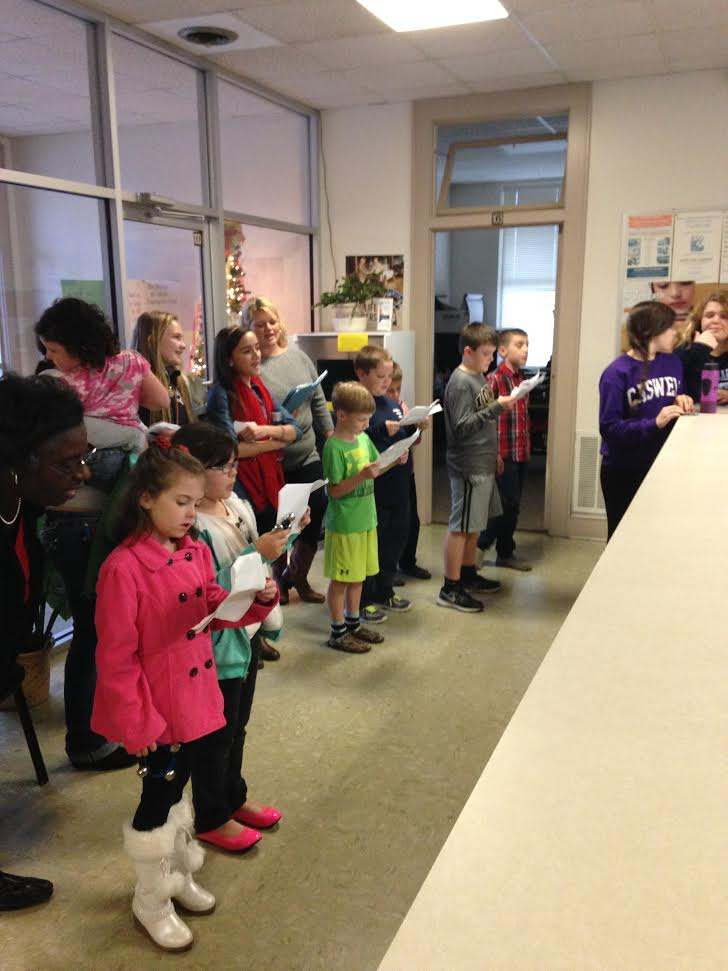 4H members go caroling at county offices