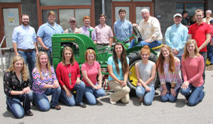 Agriculture Commissioner Steve Troxler, back row, third from right, meets with 16 of the 27 recipients of the 2016 N.C. State Fair Youth Livestock Scholarships at the Got to Be NC Festival.