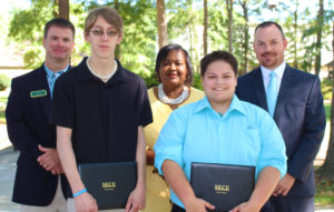 Pictured from left to right are BCC Vice President for Student Services Barry Priest,scholarship winner James Hunsinger, BCC Associate Vice President for Academic Services Cynthia McKoy, scholarship winner Taylor Mayers, and SECU Vice President and Branch Manager Rian Collins.