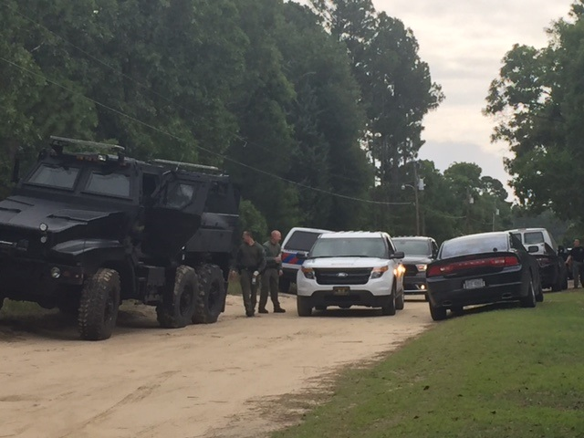 Barricaded man peacefully surrenders