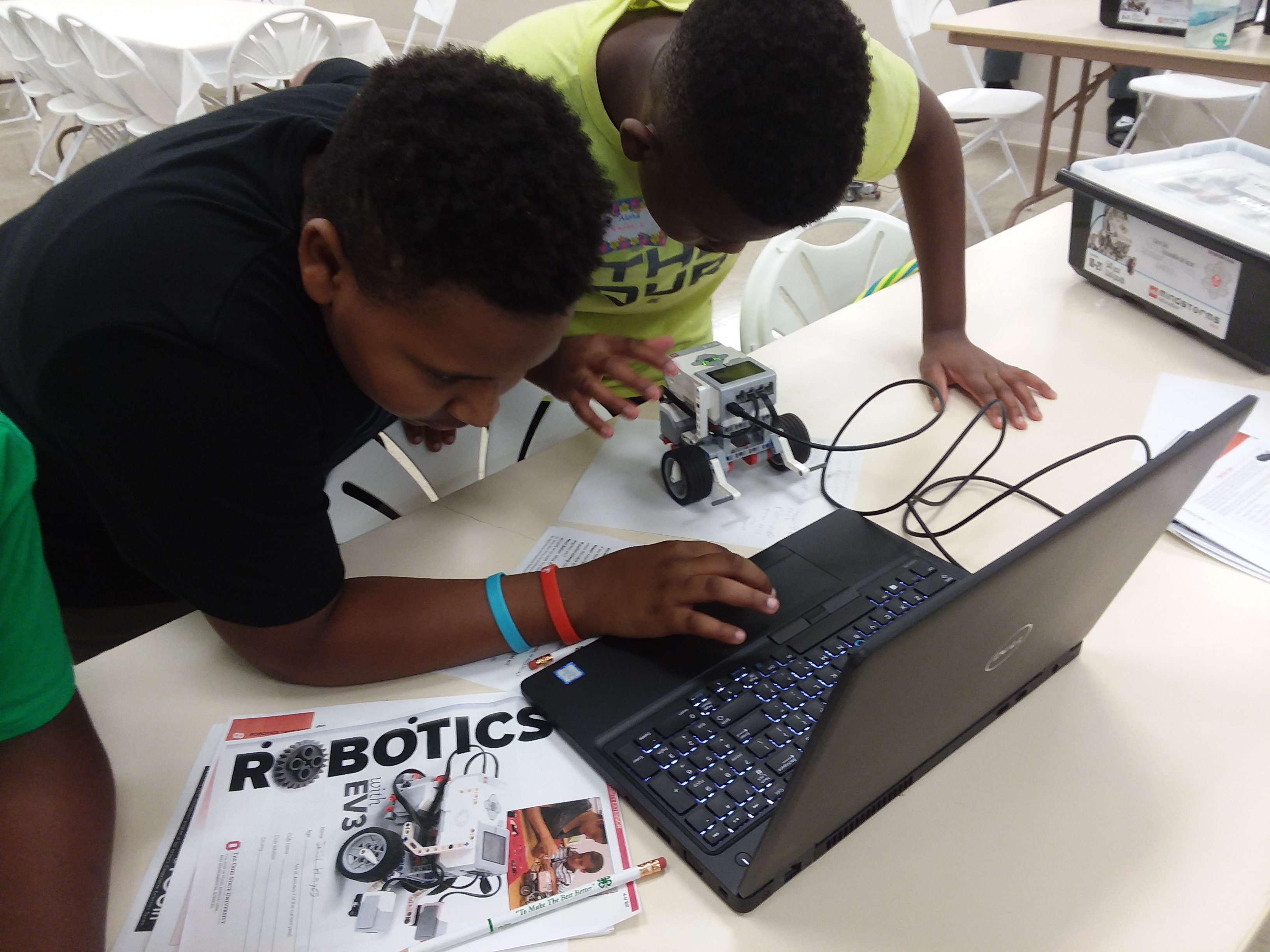 Jalil Hayes and Isaiah Lee work together to program and build their Lego Ev-3 Robot