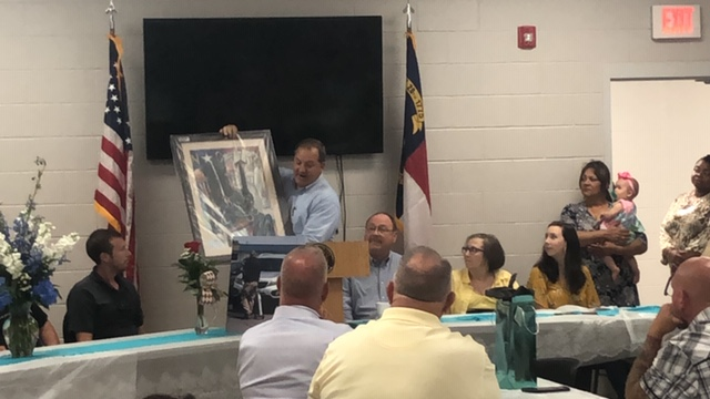 Bladen County Sheriff Major Larry Guyton of Bladen County retires painting by Kathy Bunn